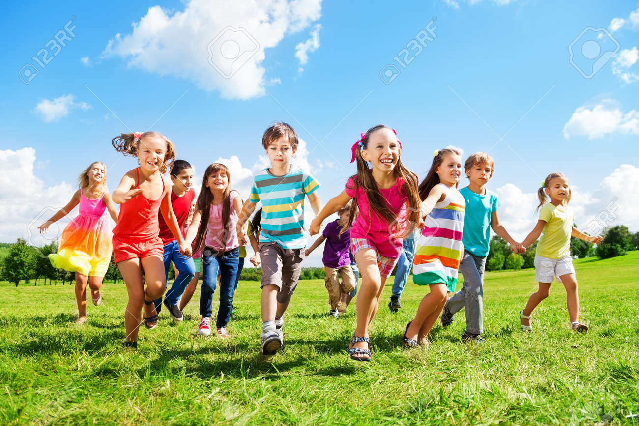 Many different kids, boys and girls running in the park on sunny summer day in casual clothes - 22404189