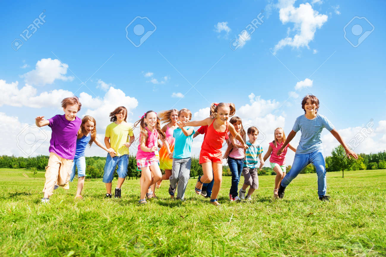 Large group of kids, friends boys and girls running in the park on sunny summer day in casual clothes - 22404192