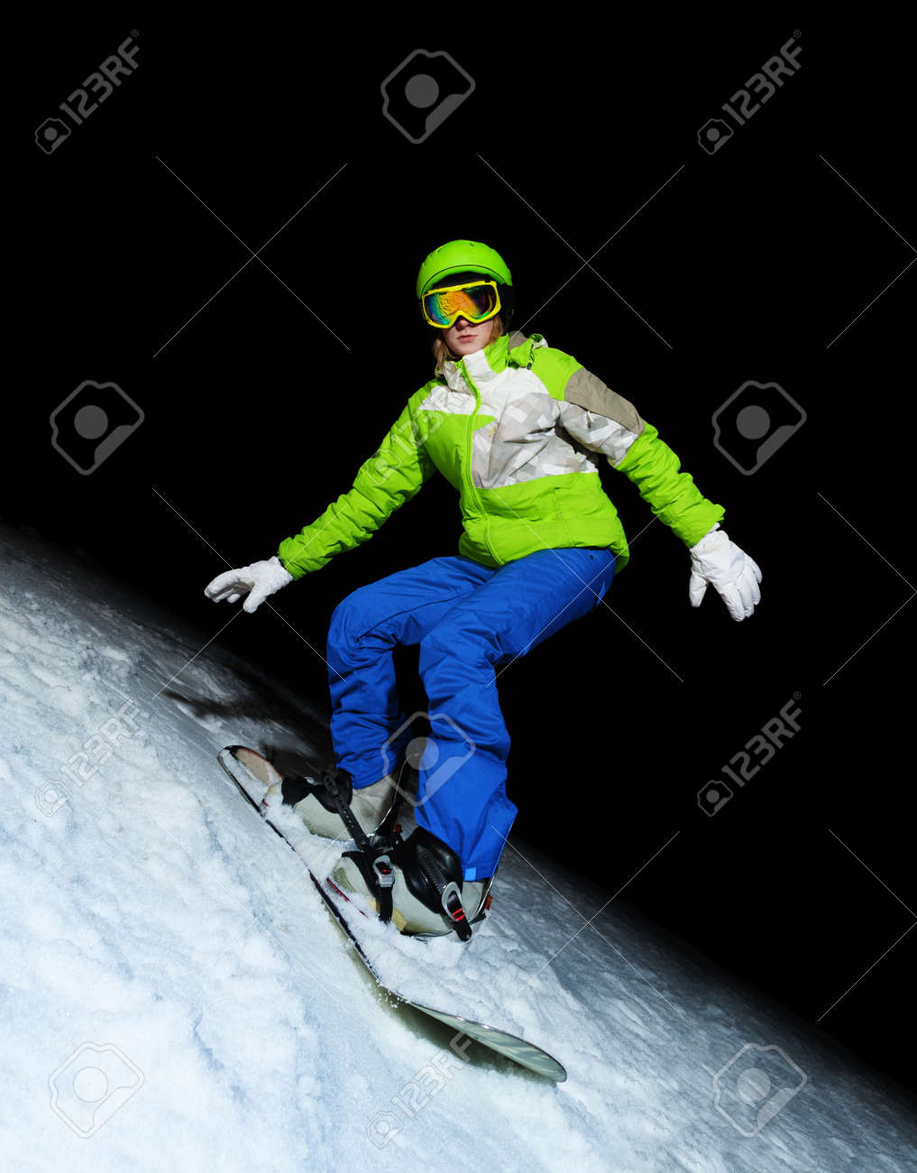 aa0d438dffac Portrait of young woman standing on snowboard wearing ski mask at night  Stock Photo - 28927532