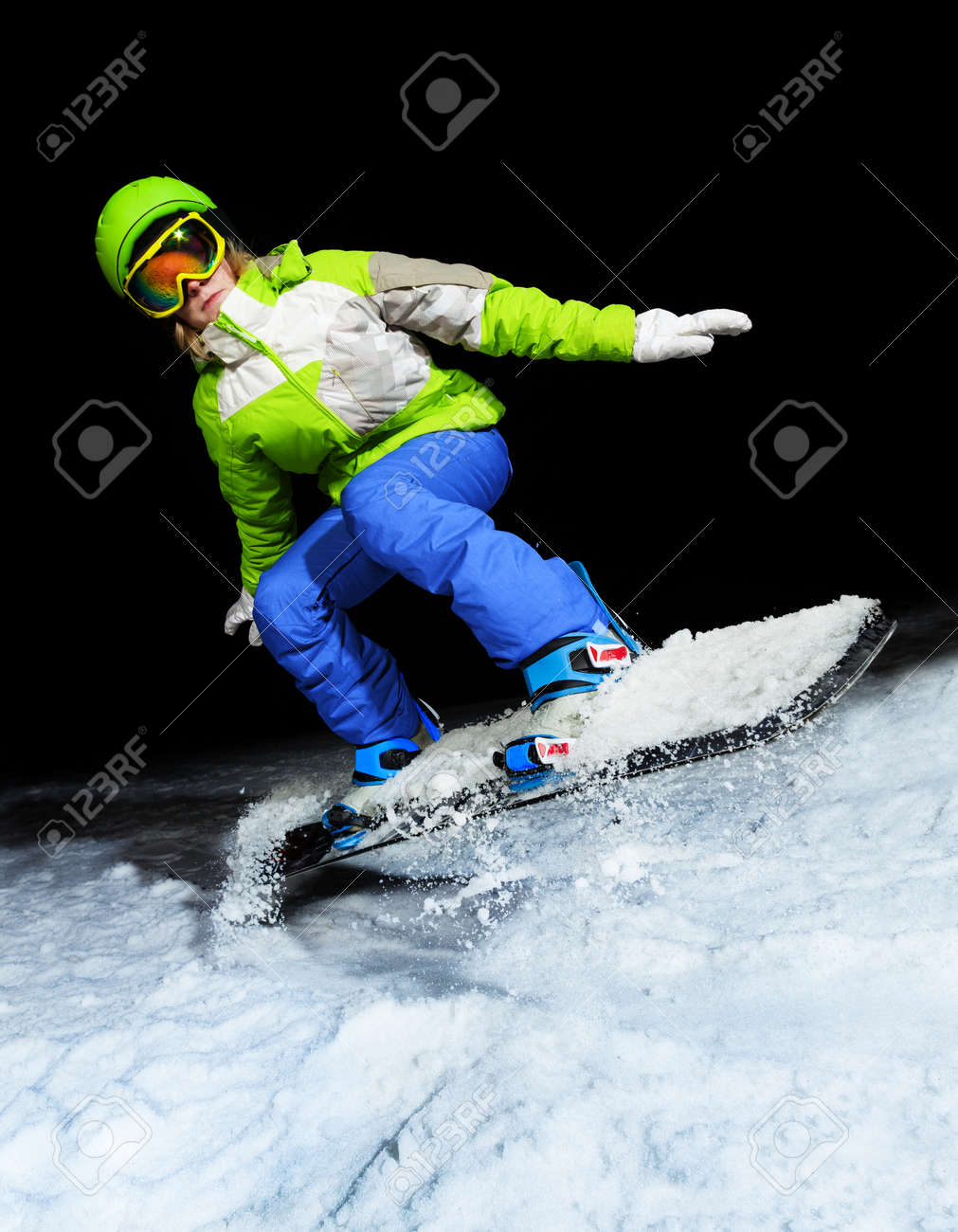 9c8c7c736c8b Portrait of girl jumping on snowboard wearing ski mask at night Stock Photo  - 28927474