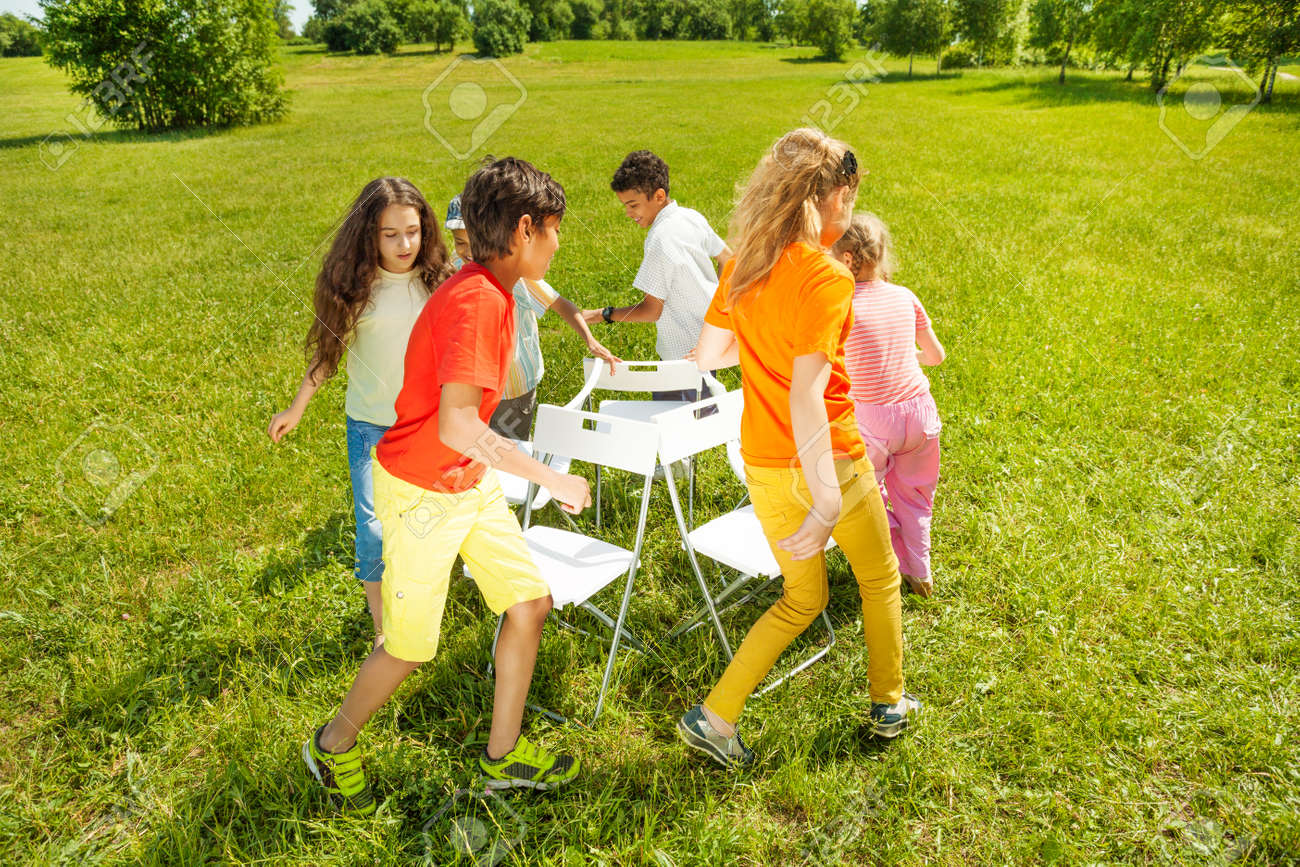 Musical chair game for kids - Kids Run Around Playing Musical Chairs Game Stock Photo 30375473