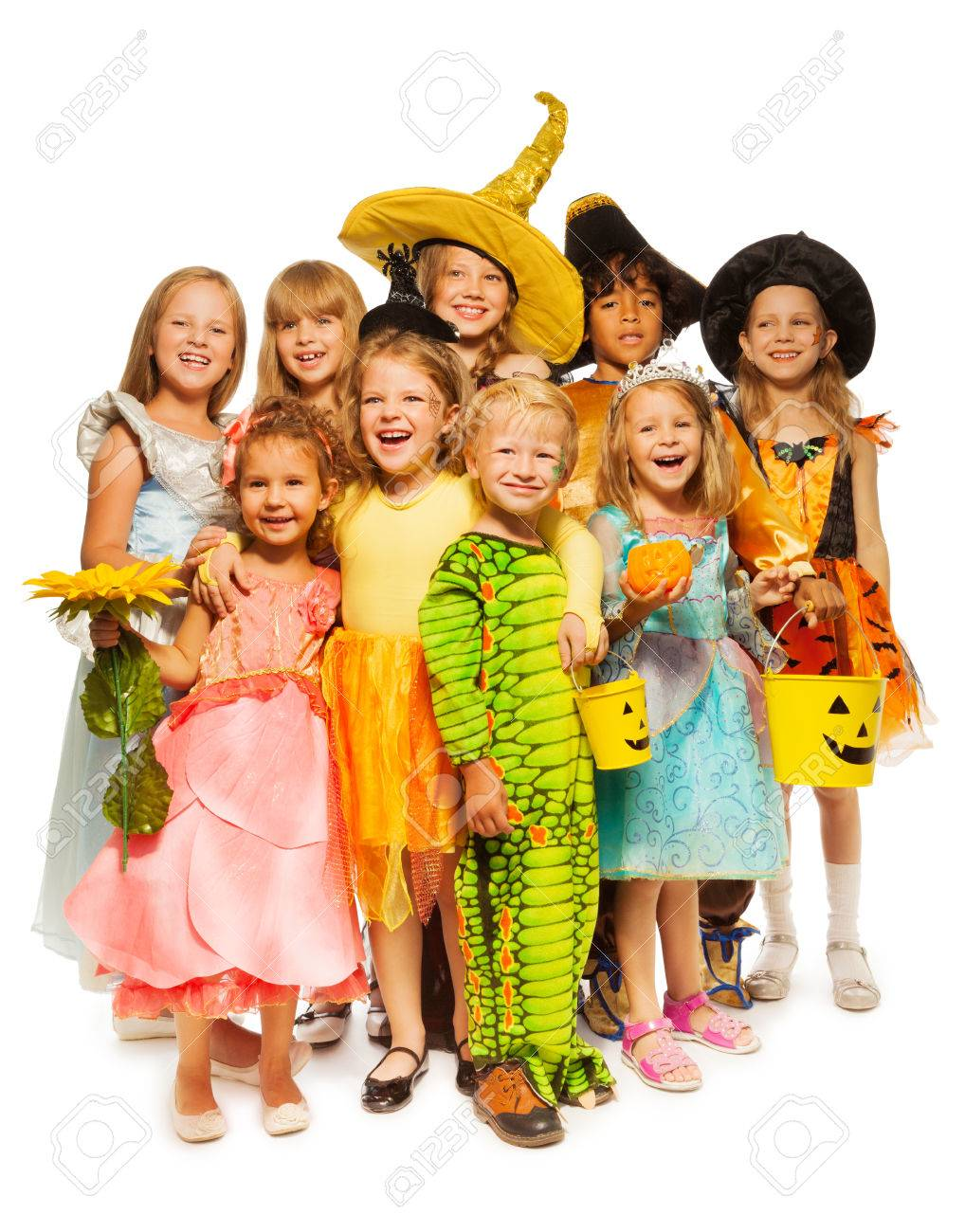 many kids stand in halloween costumes together stock photo 31454981