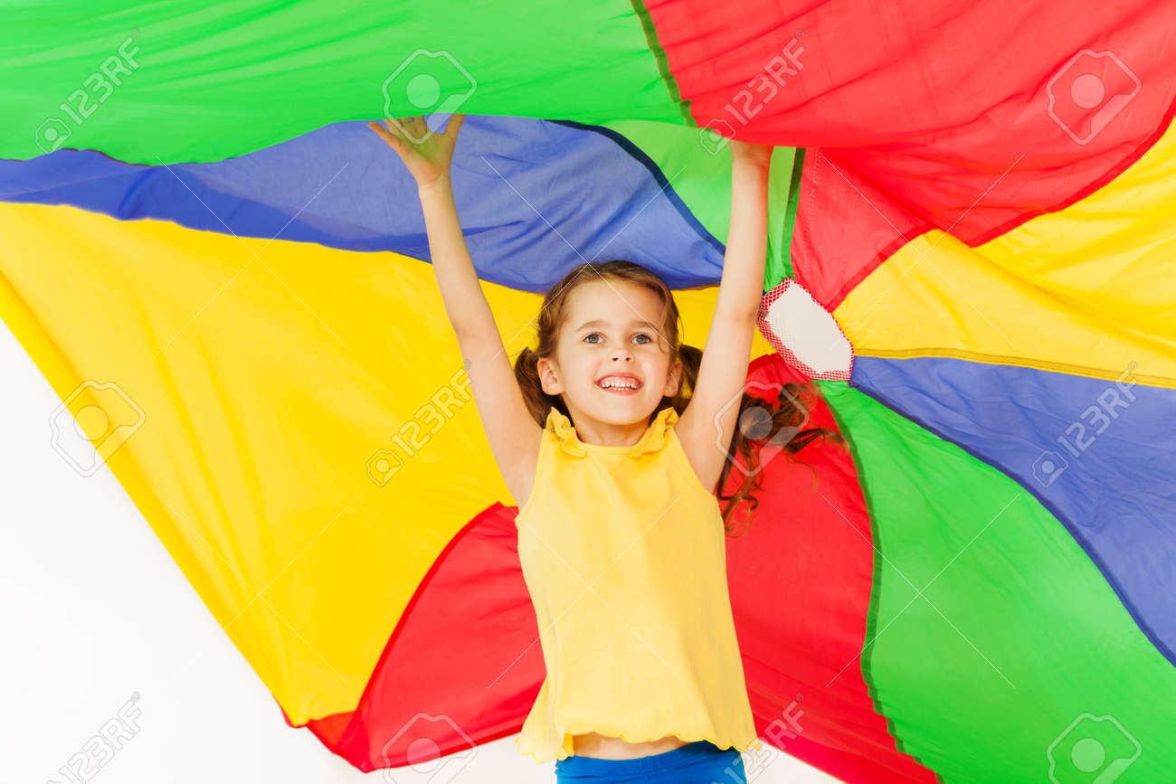 Joyful girl jumping under canopy made of parachute - 81312118