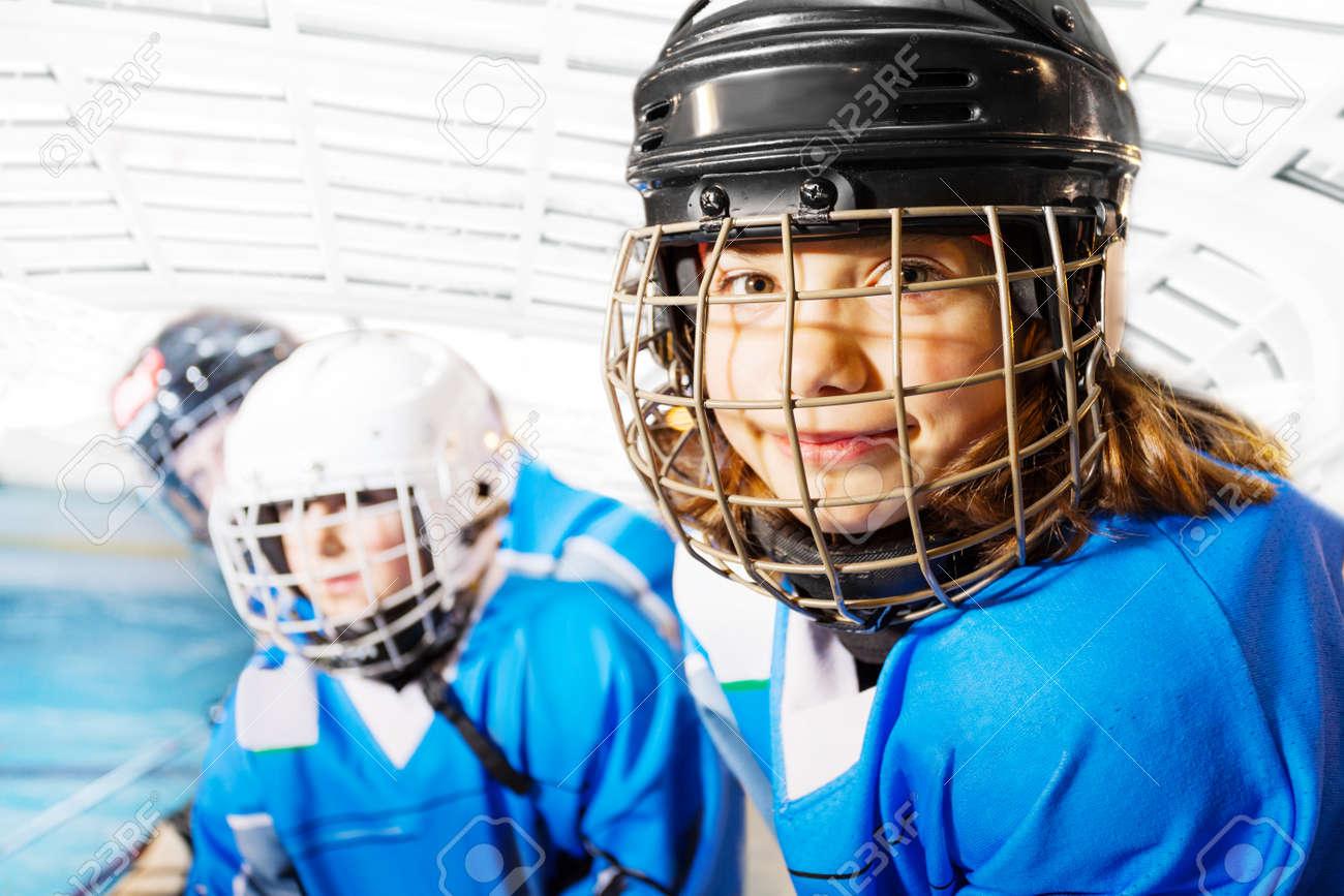 Portrait of happy girl in ice hockey uniform - 114500210