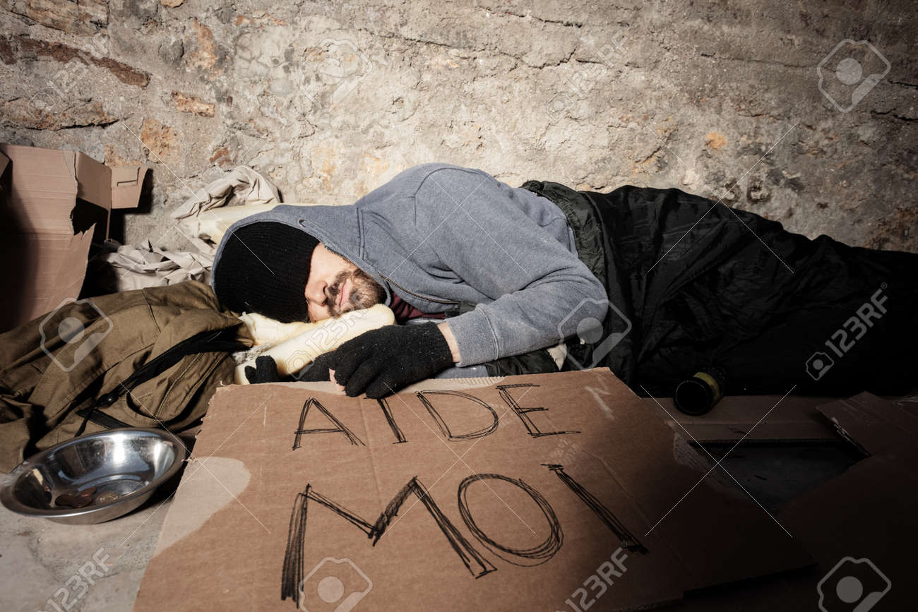 Homeless man in old clothes sleeping on the street - 115373248