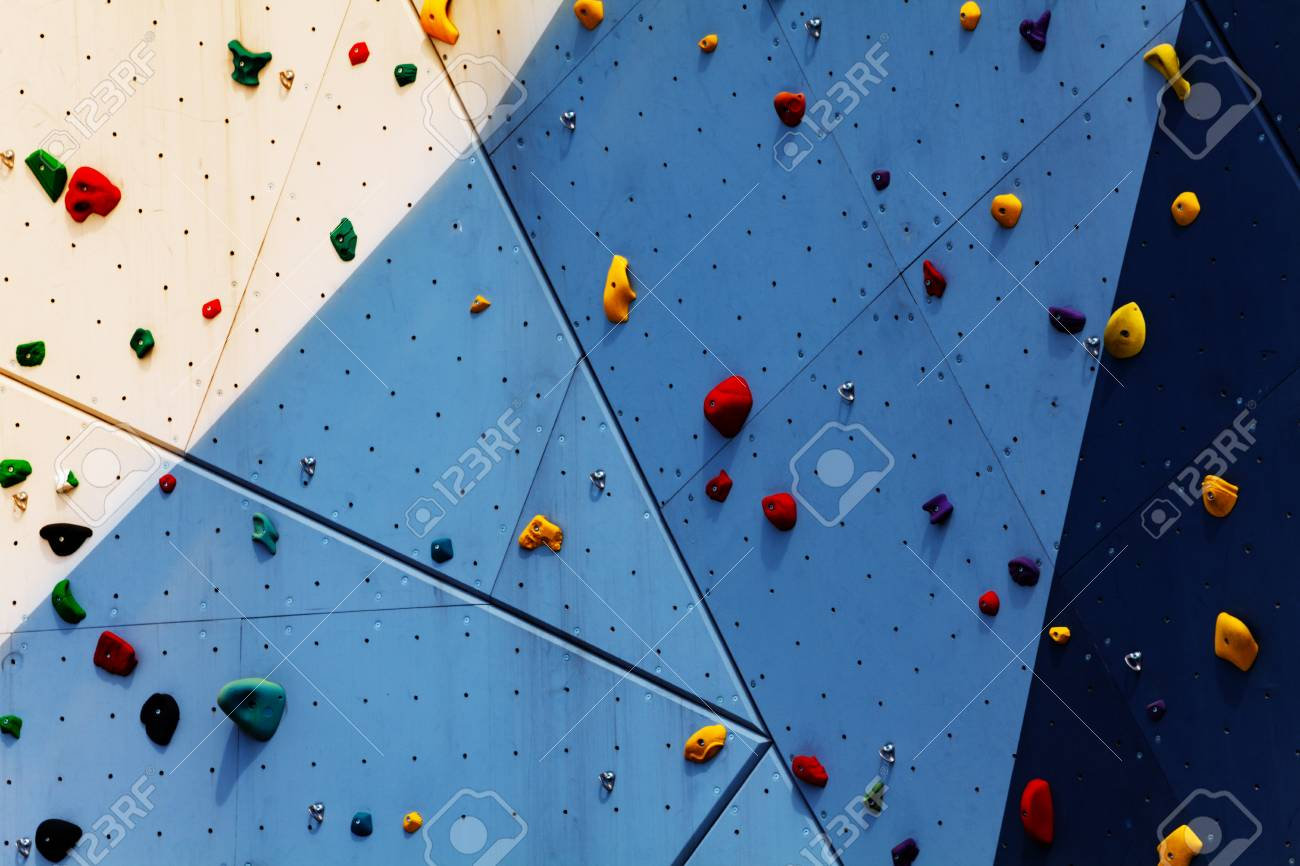 Close-up of climbing exercise wall with grips - 119380668