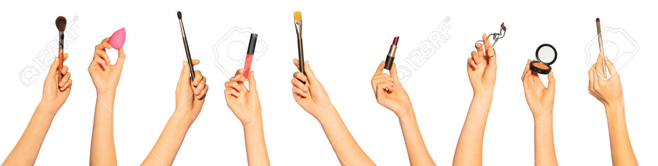 Hands with make-up brushes and beauty cosmetics - 125269498