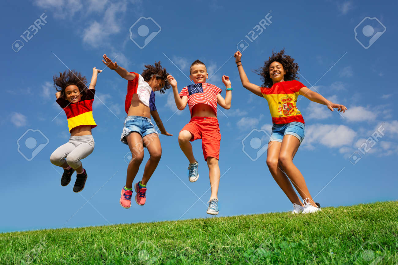 Many kids in different national flag shirts jump - 133472868