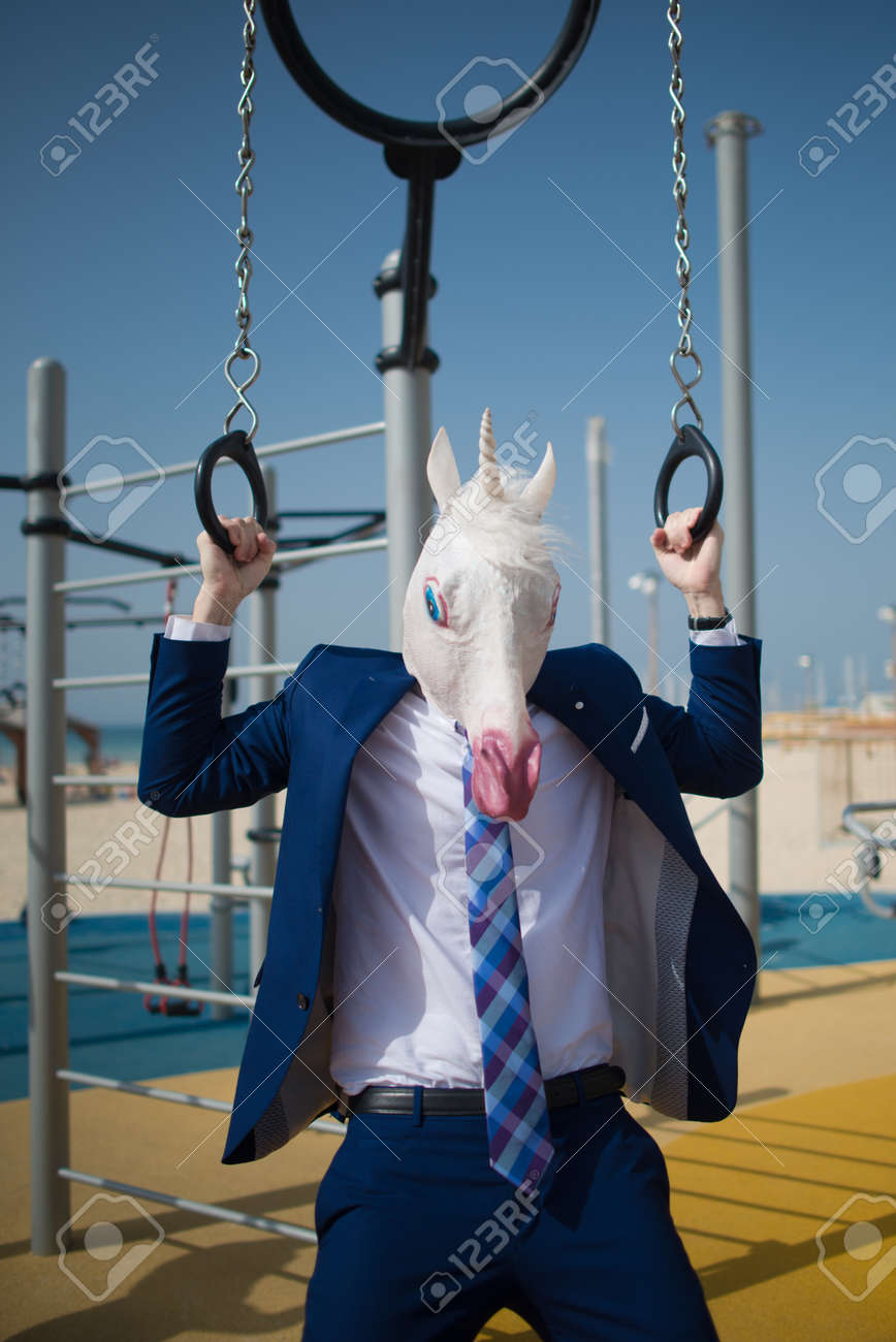 Funny Fitness Trainer In Suit And Horse Mask Does Biceps Exercises Stock Photo Picture And Royalty Free Image Image 98921152