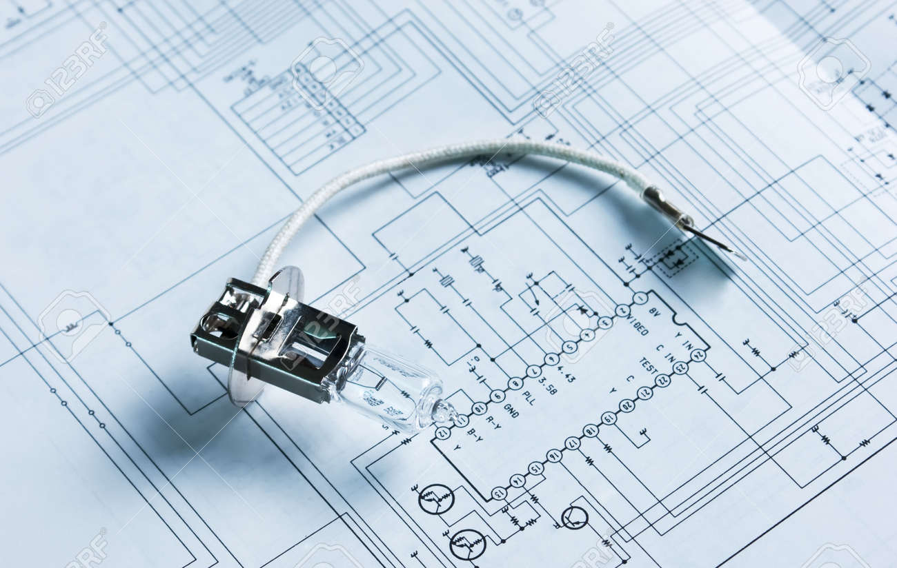 halogen lamp on the background of electric circuit on