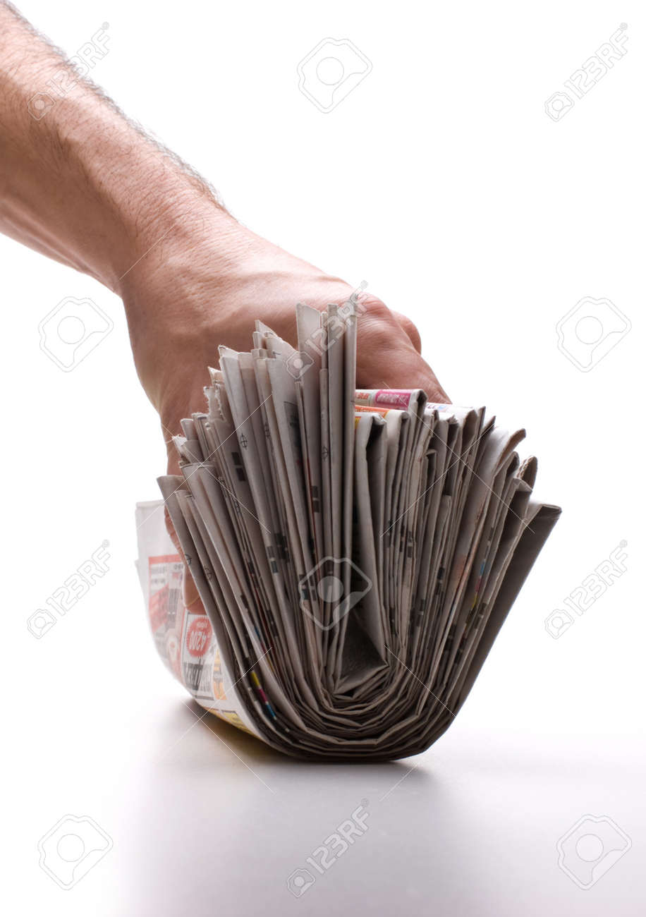 hand holds a bundle of newspapers isolated on a white background Stock Photo - 7242666