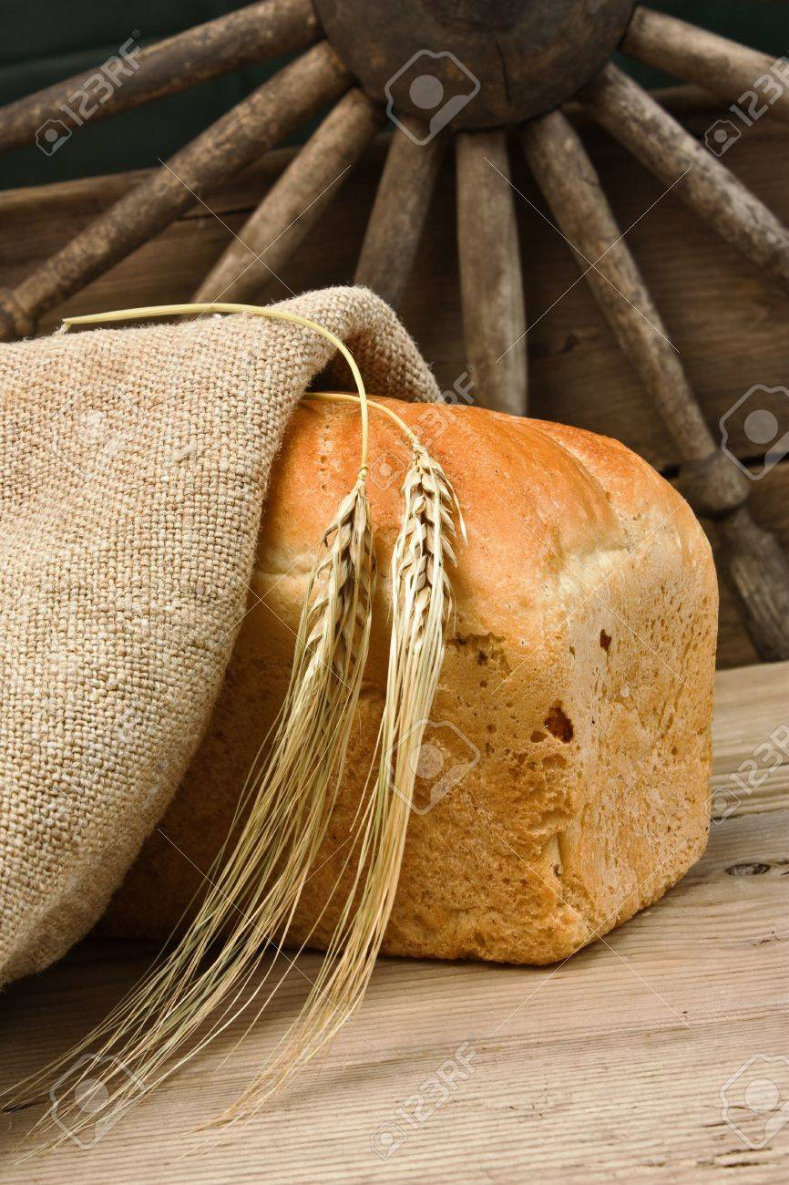 wheat bread on the wooden table Stock Photo - 10346141