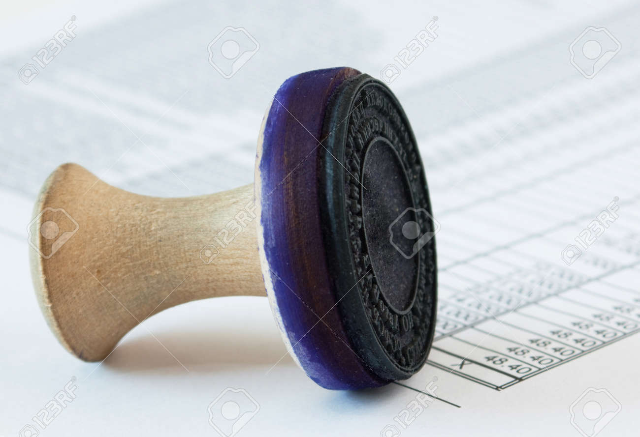 old wooden press and financial documents Stock Photo - 17128159