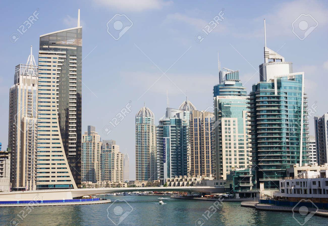DUBAI, UAE - NOVEMBER 16: Modern buildings in Dubai Marina, on November 16, 2012, Dubai, UAE. In the city of artificial channel length of 3 kilometers along the Persian Gulf. - 18480017