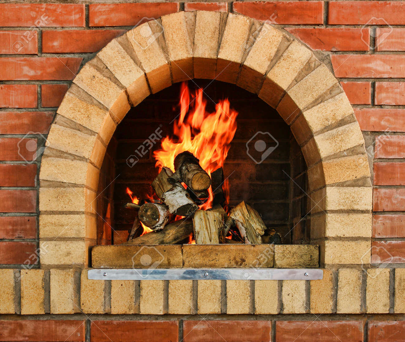 Russian interior kitchen with an oven and a burning fire Stock Photo - 18812510