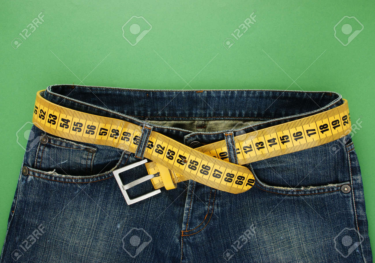 jeans with meter belt slimming on the green background - 19833494