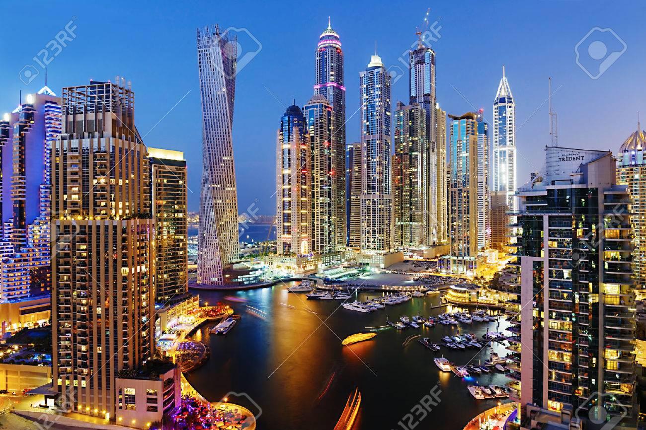 DUBAI, UAE - NOVEMBER 2: Dubai Marina at Dusk from the top, on November 2, 2013, Dubai, UAE. In the city of artificial channel length of 3 kilometers along the Persian Gulf. - 24010815