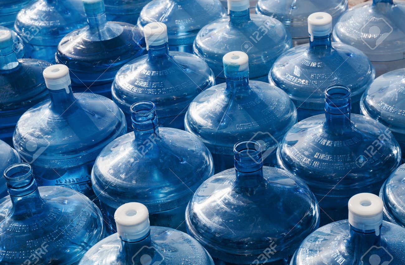big empty water bottles in a row - 24311740