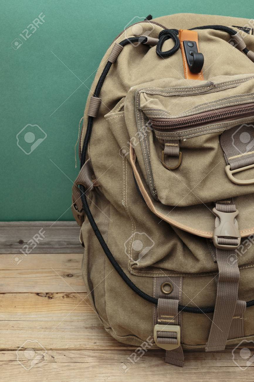 old travel backpack on the floor - 27103688