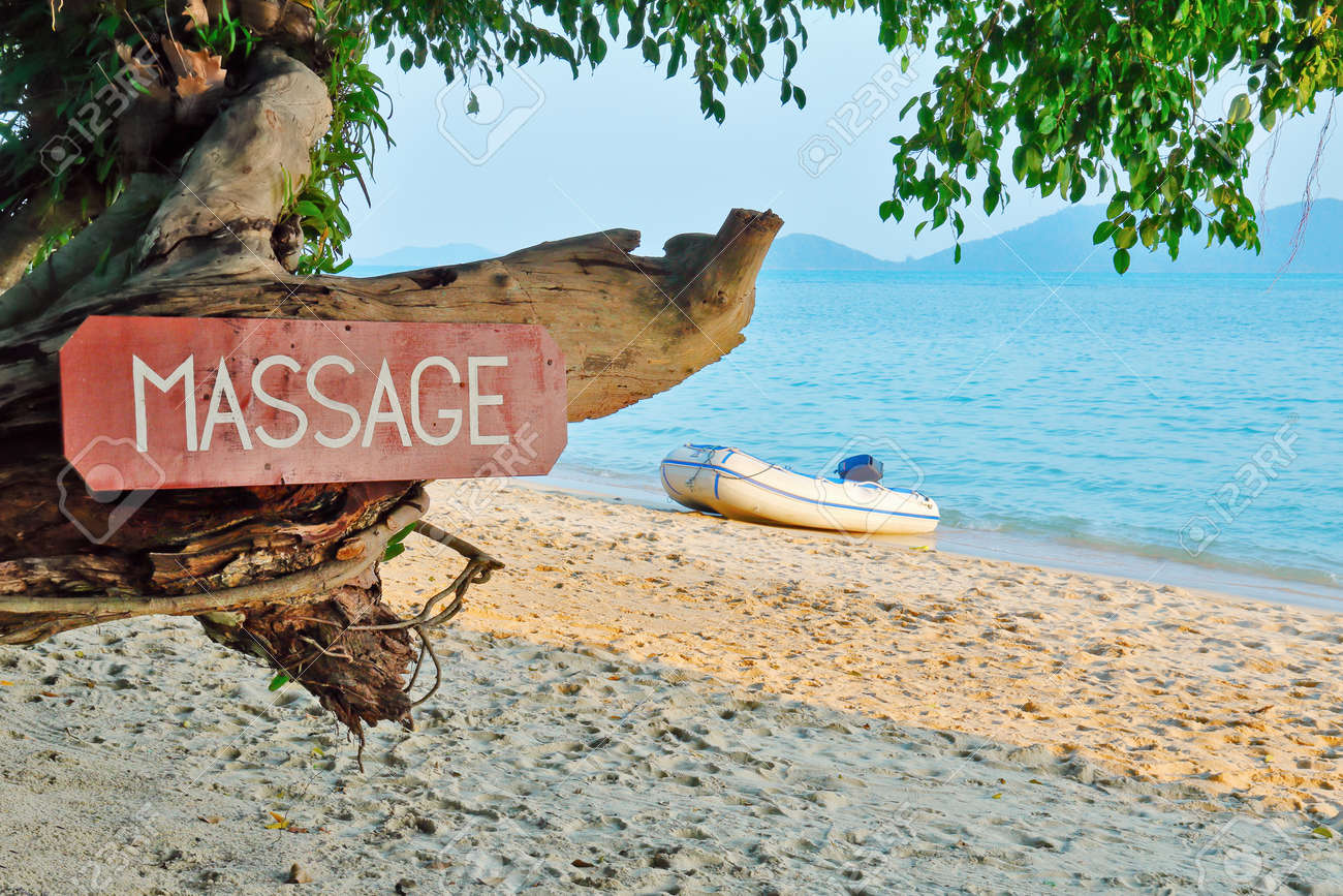 Old signboard with the inscription, massage, on a tropical beach - 38701989