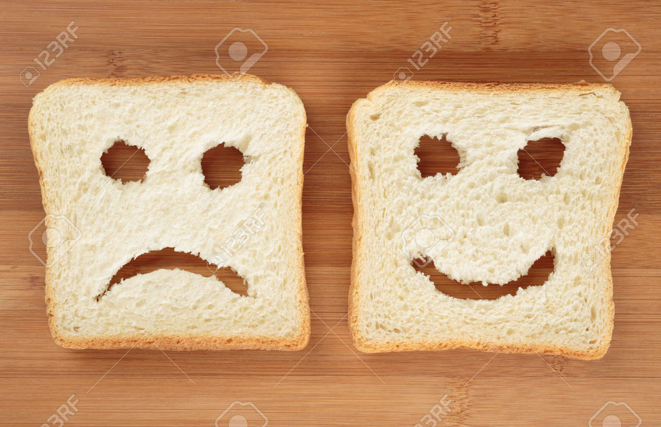 Happy and sad toast breads on a cutting board - 44592632