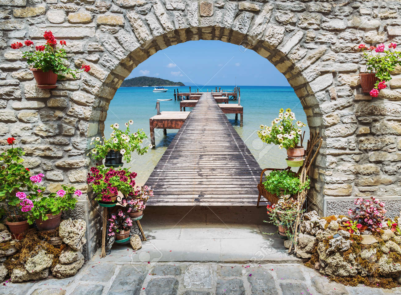 Seaview through the stone arch with flowers in Italy - 51640900