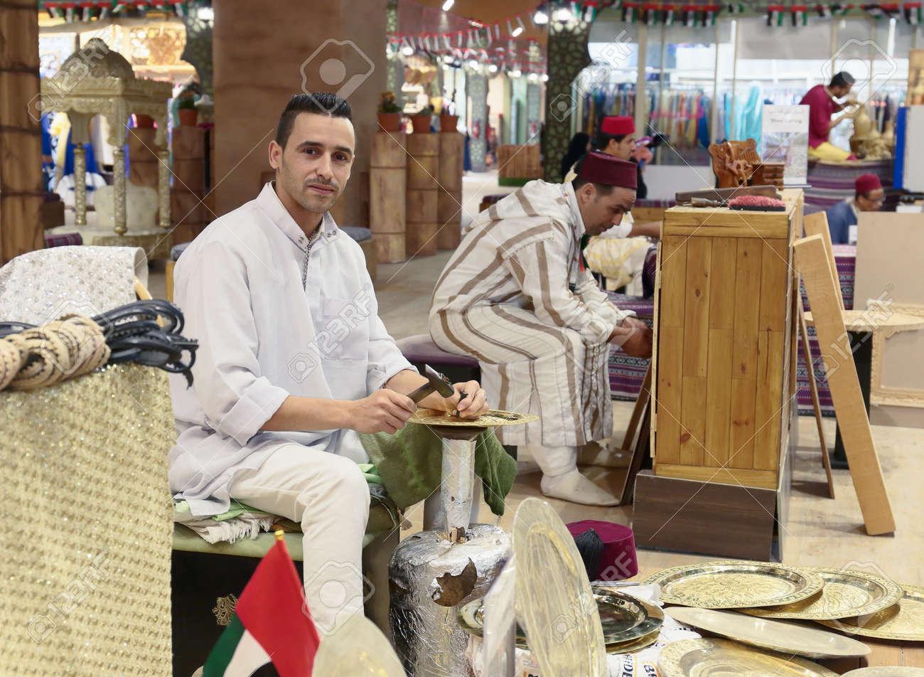 DUBAI, UAE - DECEMBER 4, 2017: Minter artisan in national clothes