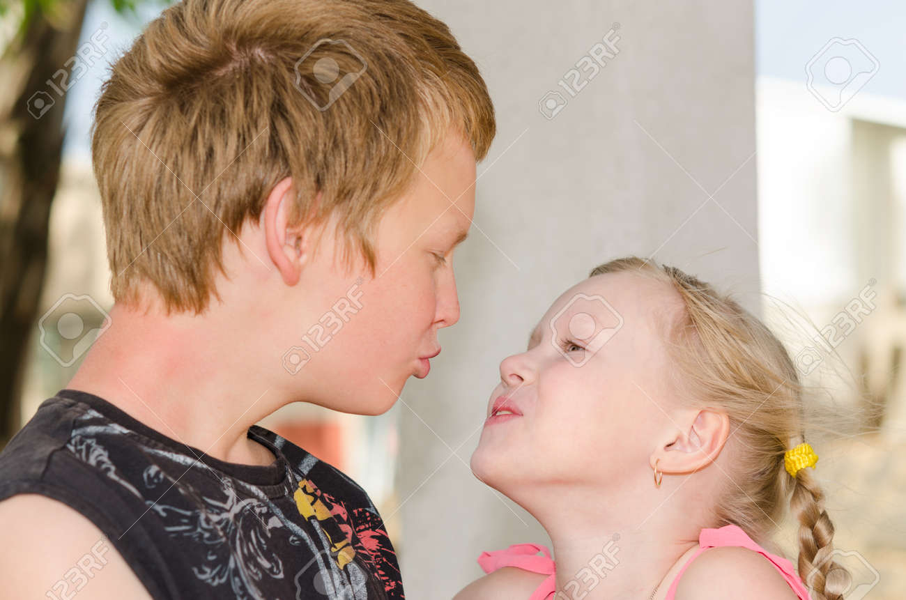 First love and kiss  two happy cute kids meeting Stock Photo - 24058536