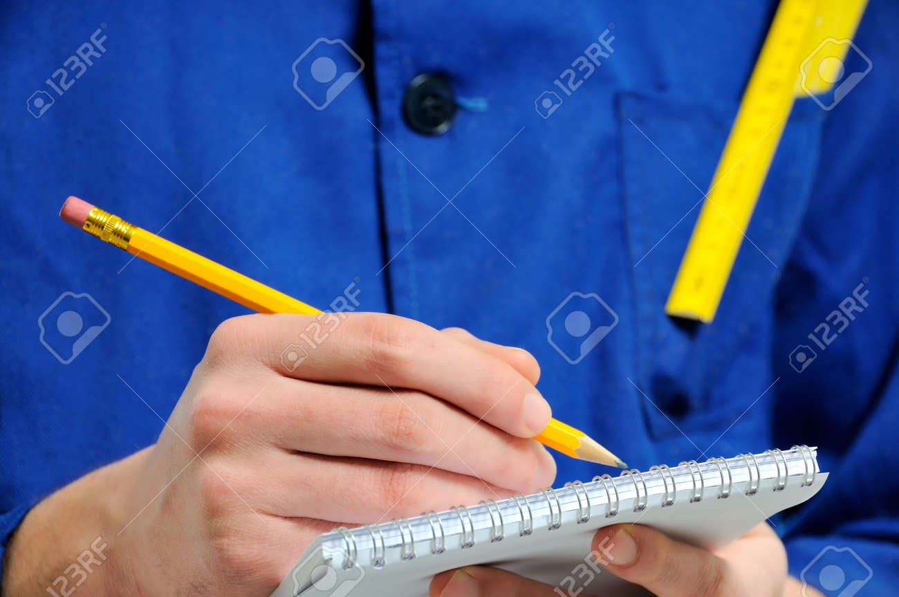 Worker taking notes close-up Stock Photo - 6967810