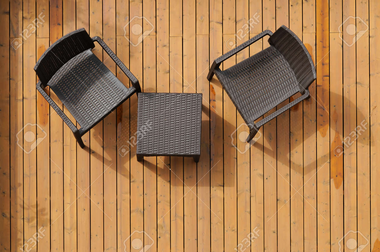 Table and chairs on the wooden floor  Pictured from above Stock Photo - 14177268