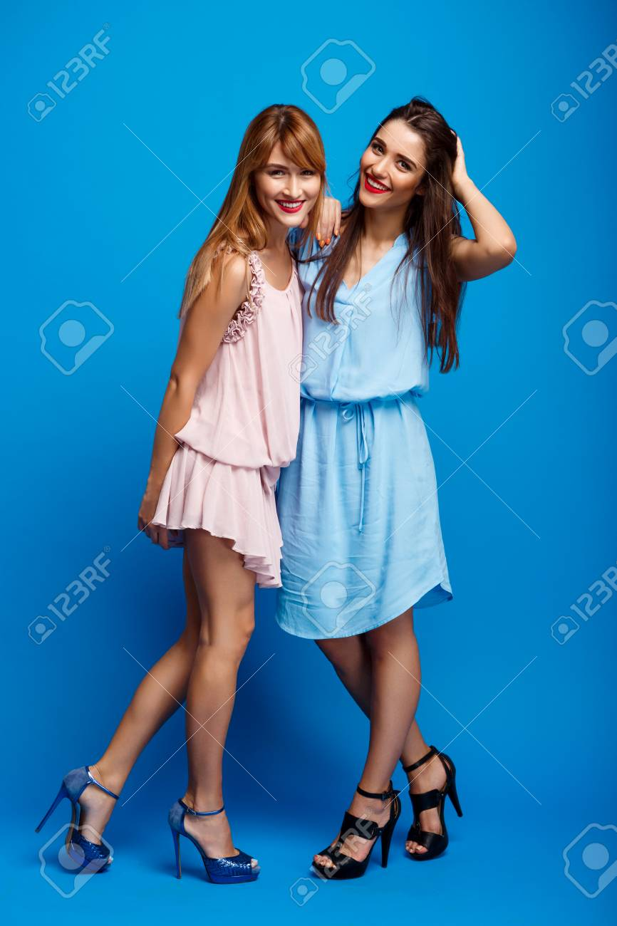 dba4da1c9 Portrait Of Two Young Beautiful Girls In Dresses Looking At Camera ...