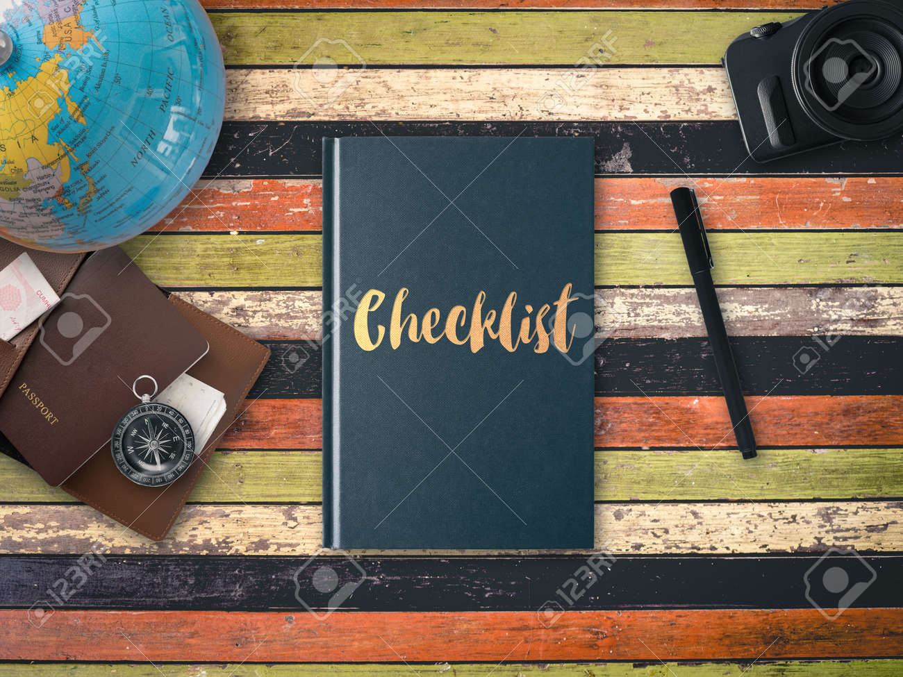 Flat lay of checklist travel book with globe map compass camera flat lay of checklist travel book with globe map compass camera and passport pocket stock gumiabroncs Image collections