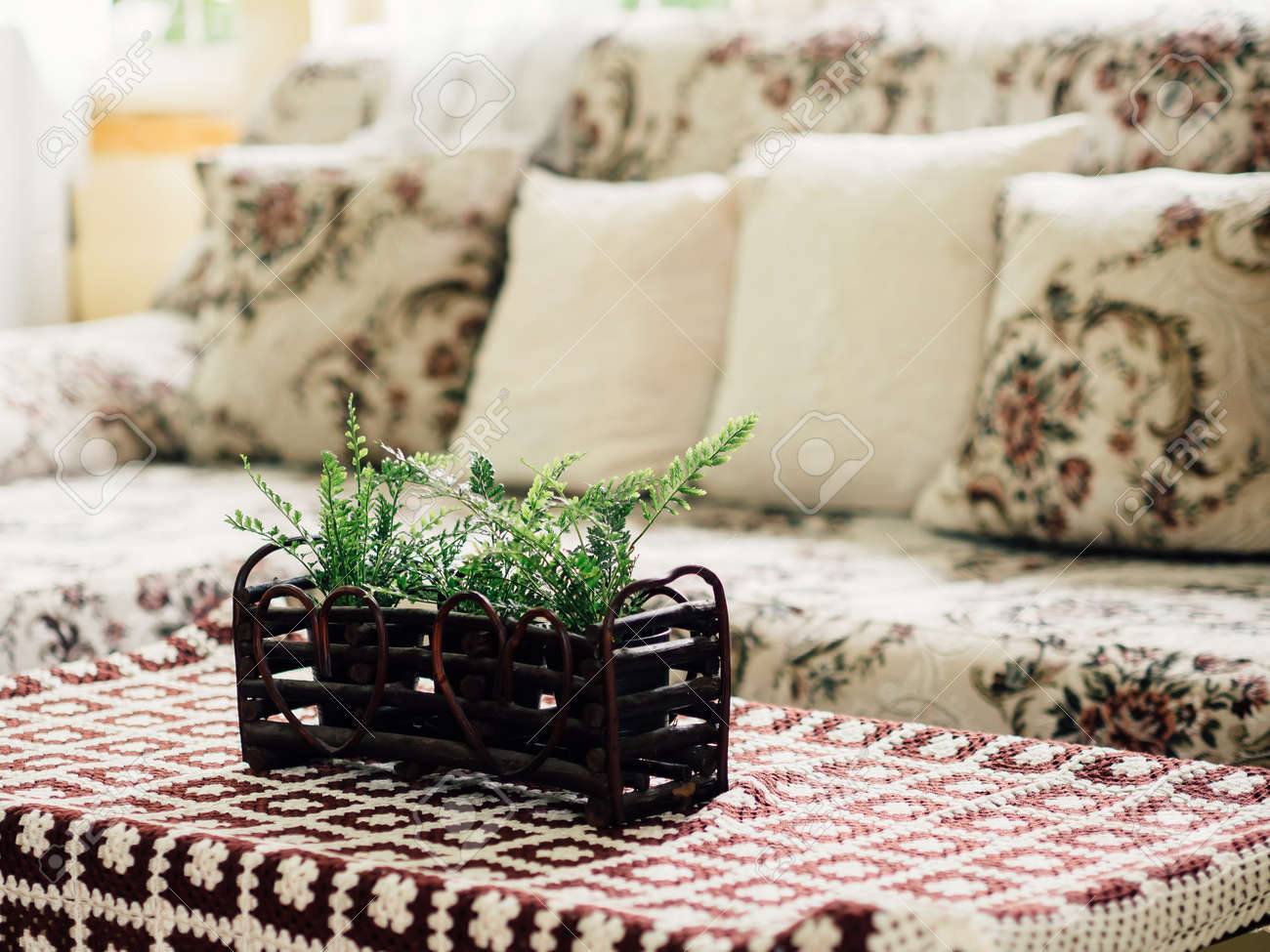 High Quality Fake Plastic Plants Decorated On The Table And Sofa Set In Living Room.  Stock Photo