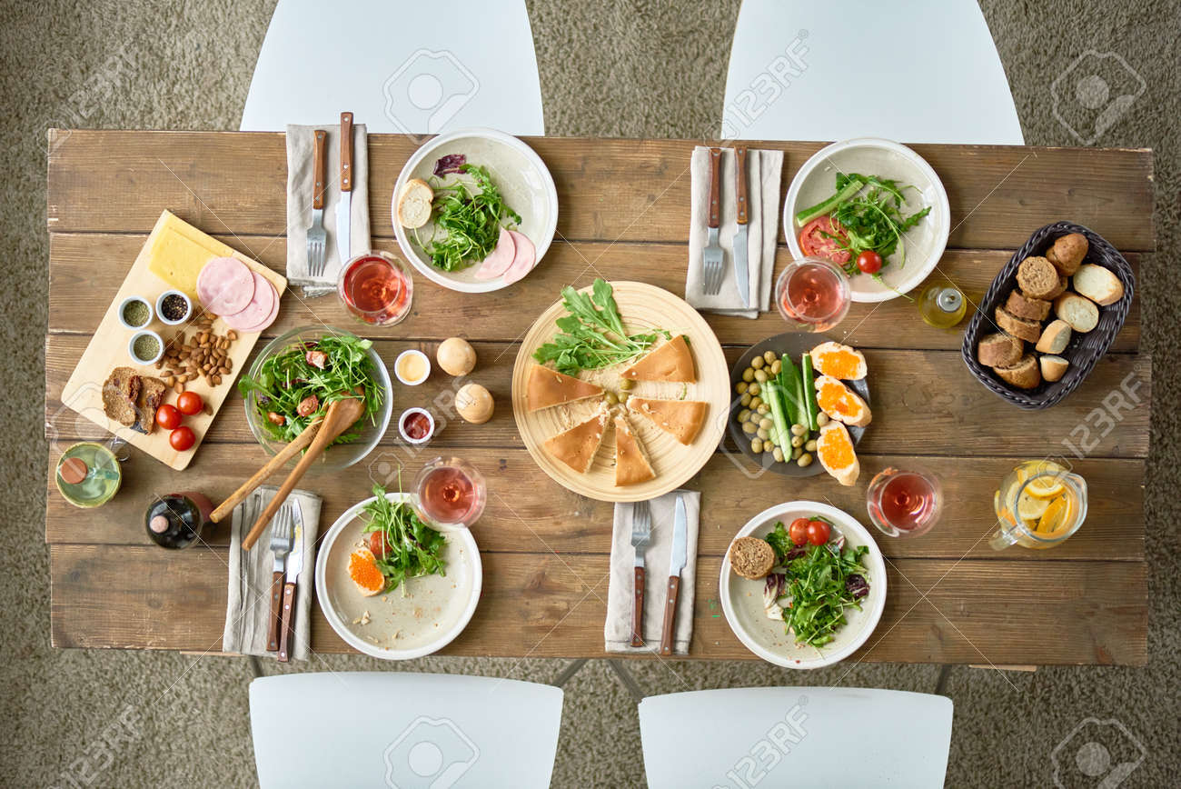 Above view background of dinner table with delicious food set for four in dining room at & Above View Background Of Dinner Table With Delicious Food Set ...