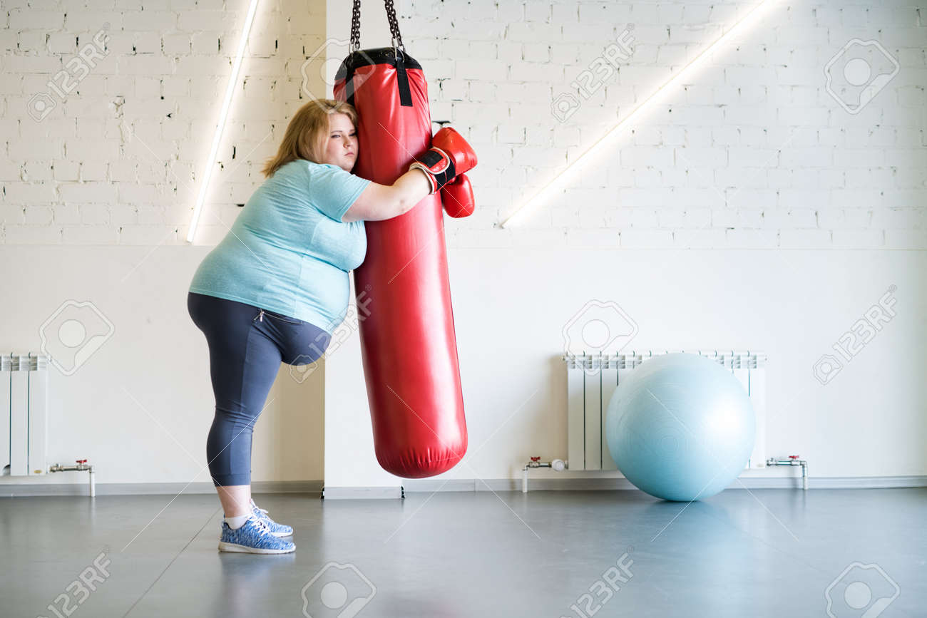 Sad Obese Woman Training in Gym - 98206993