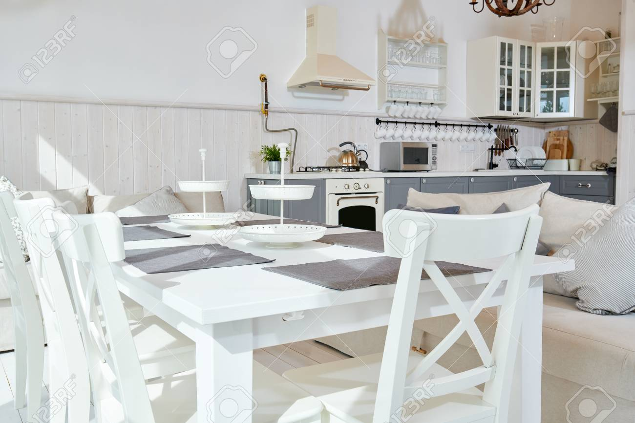 Sunlit Open Kitchen Interior Design With White Furniture And Stock Photo Picture And Royalty Free Image Image 101794292