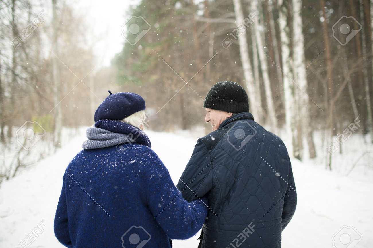 Senior Couple in Winter Forest Back View - 110025746