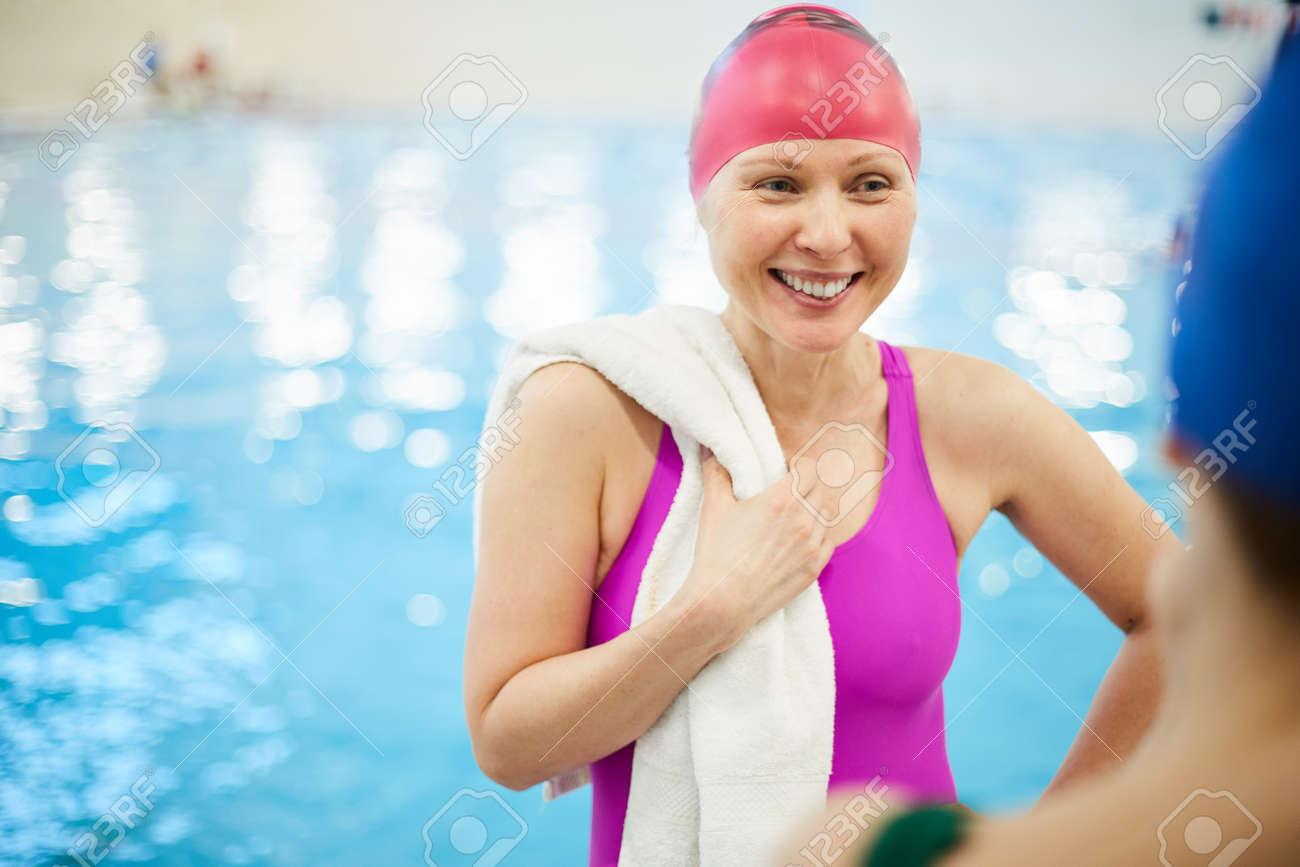 Cheerful Senior Woman at Pool - 117100014