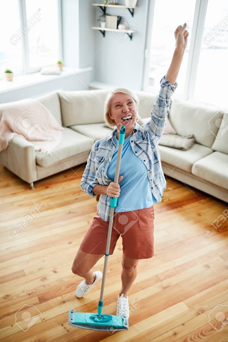 Dancing while washing floor - 119820404
