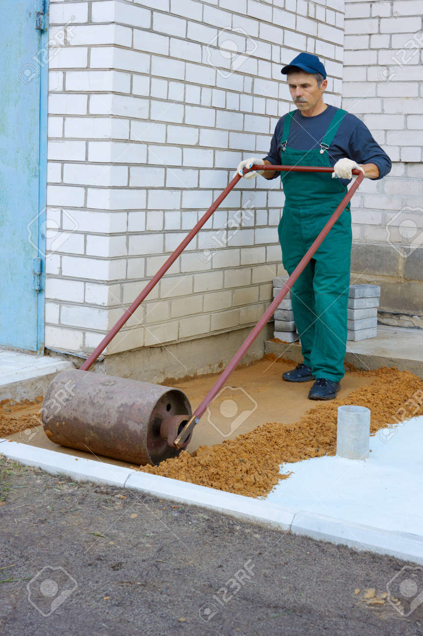 The worker prepares a place for a paving Stock Photo - 7907560