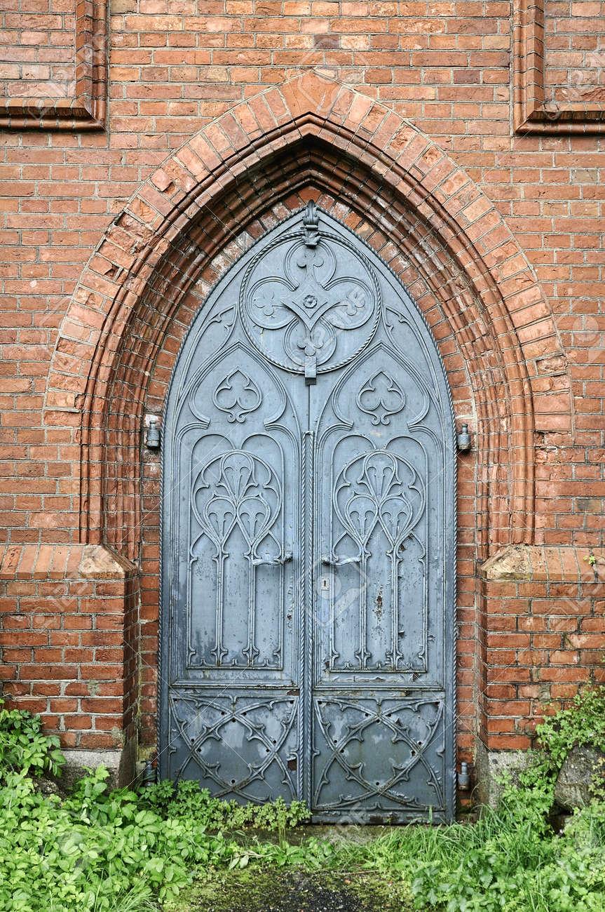 gothic door: Old gothic church metal door. Red brick arch Stock Photo & Gothic Door Stock Photos \u0026 Pictures. Royalty Free Gothic Door ... Pezcame.Com