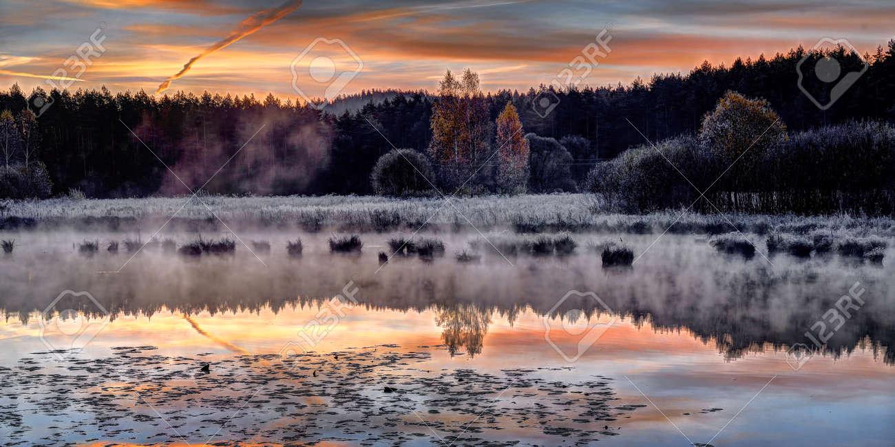 Beautiful sunrise over quiet lake. October morning near Vilnius, Lithuania - 118422643