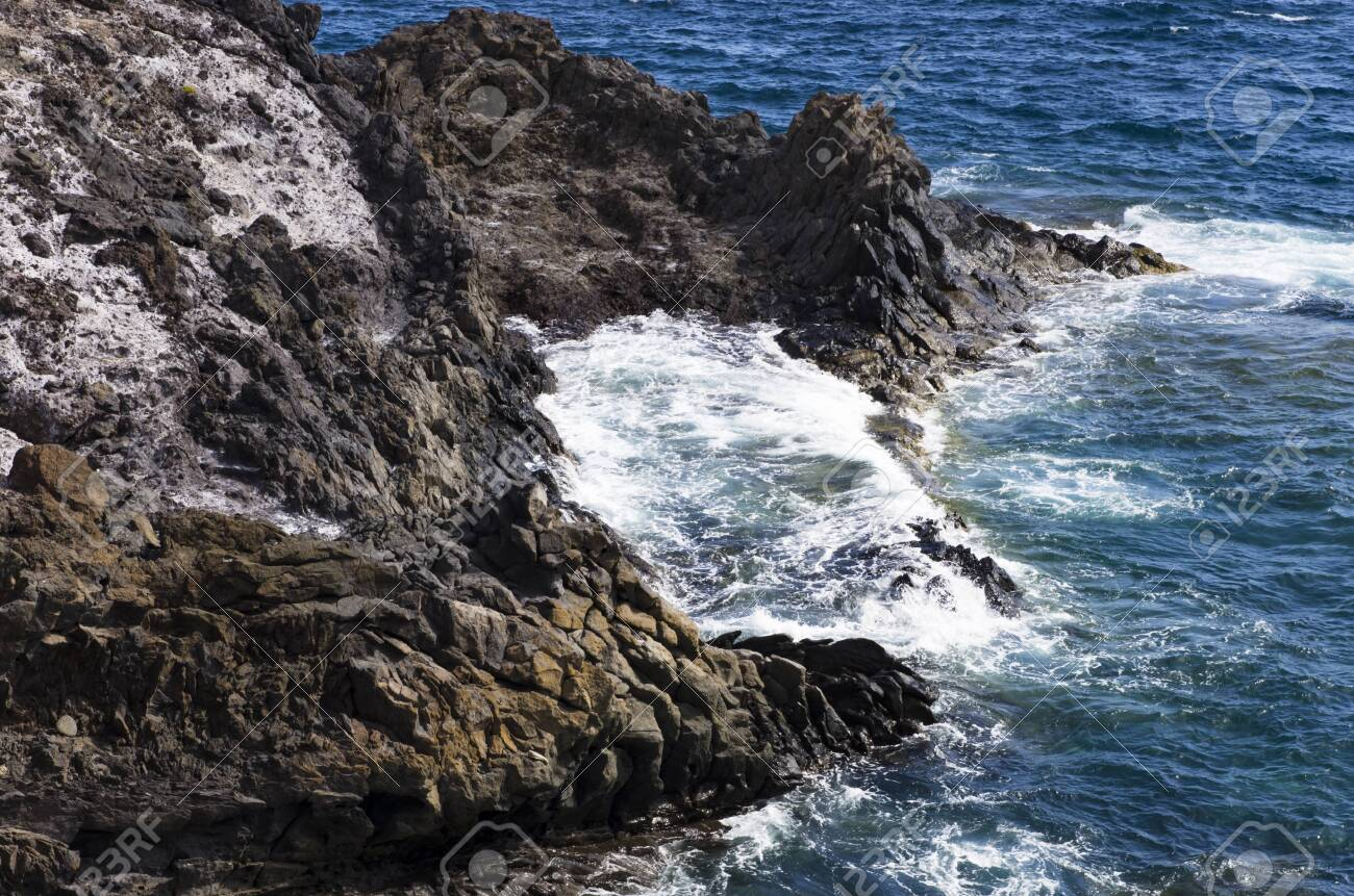 Coastal cliffs in the sea surf, landscape - 138712978