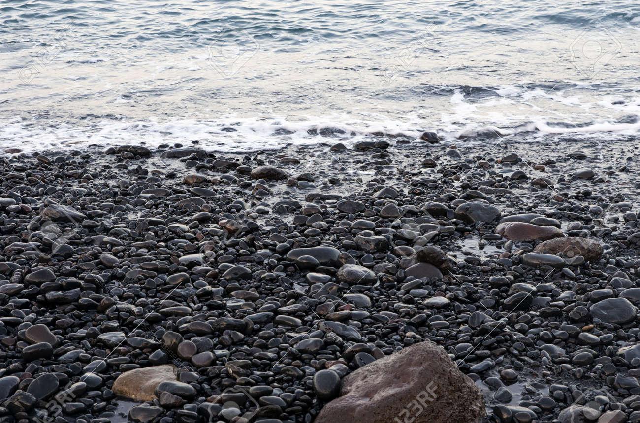 Sea surf on a black volcanic beach - 148020732