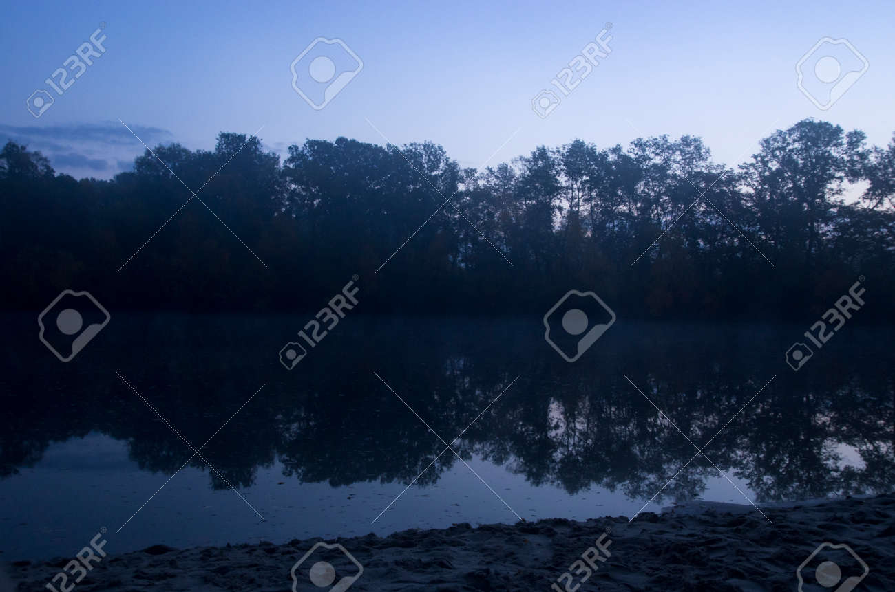 Autumn dawn over a quiet river - 158123228