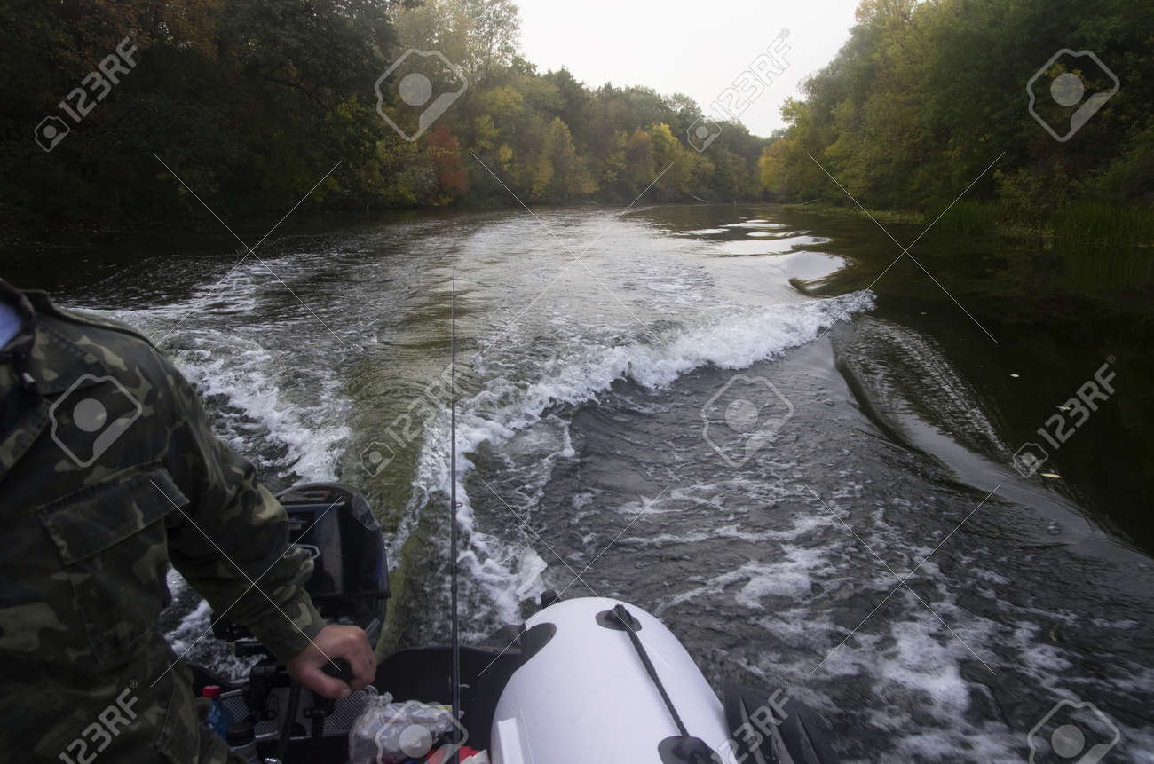 Ride on an inflatable boat on the autumn river - 158532318