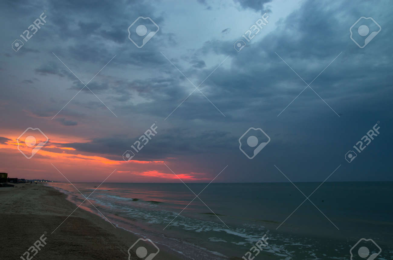 Sunset over the sea in cloudy weather, landscape - 158581469