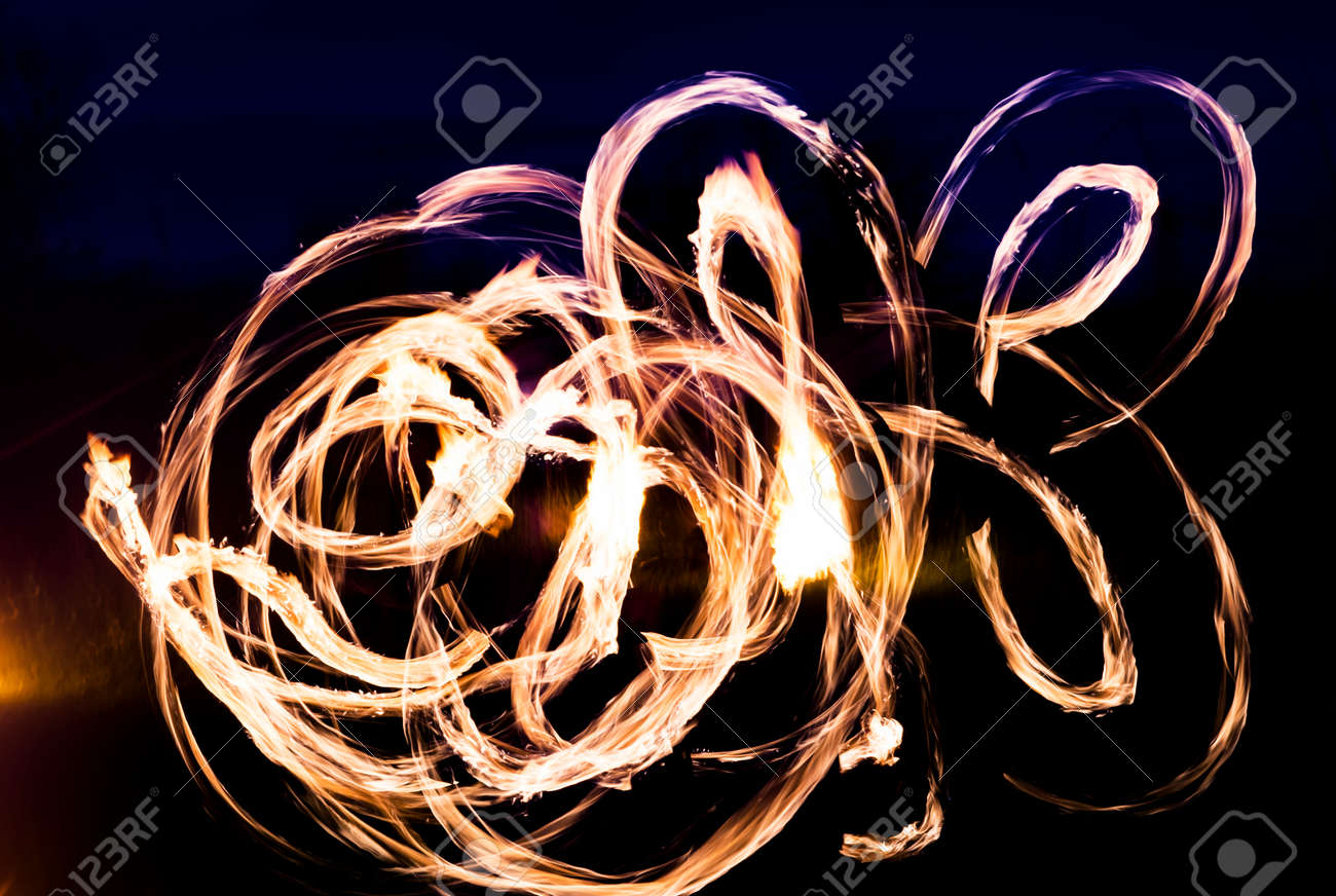 Colorful fire show of lights in the dark, background - 158581539