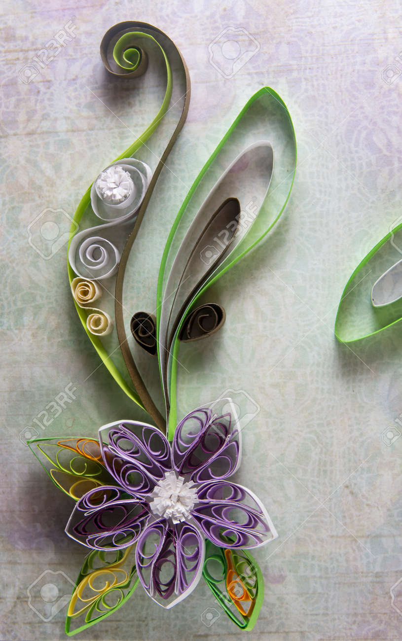 Quilling in the form of a flower on background paper - 159232584