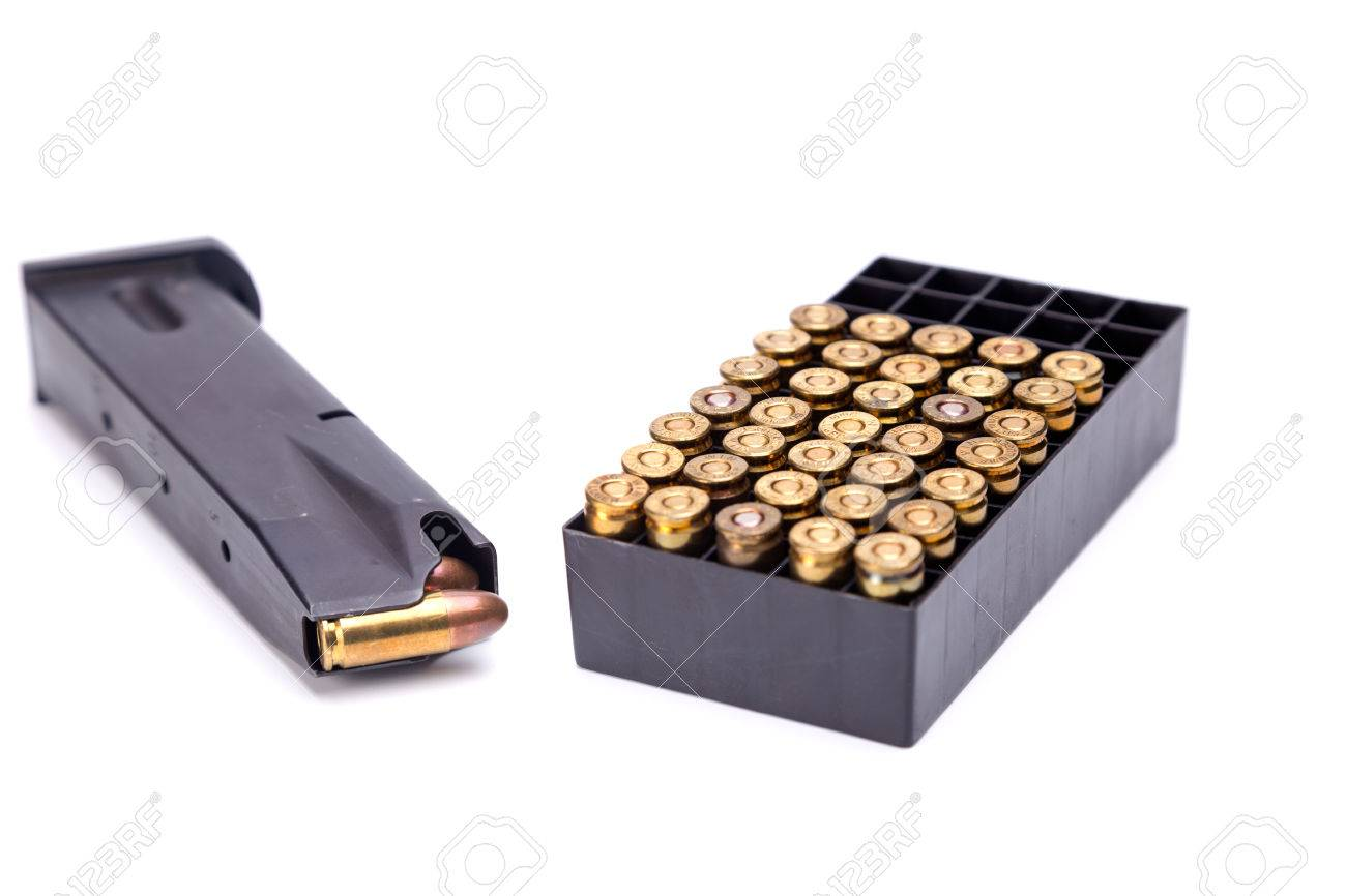 9mm.magazine with bullet box isolate on white background shallow depth of field focus on  sc 1 st  123RF.com & 9mm.magazine With Bullet Box Isolate On White Background Shallow ...